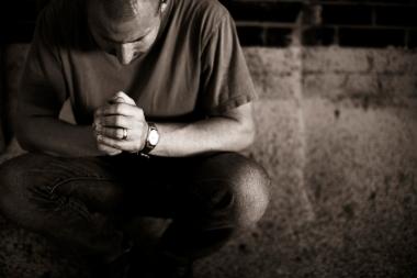 lightstock_man-in-prayer_small-1024x682